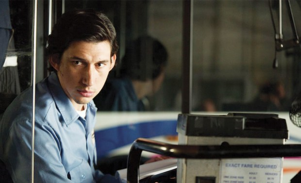 Adam Driver sitting on a bus in Paterson film