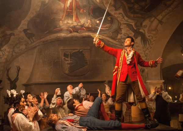 Luke Evans Gaston Holding A Sword During The Number From Beauty And