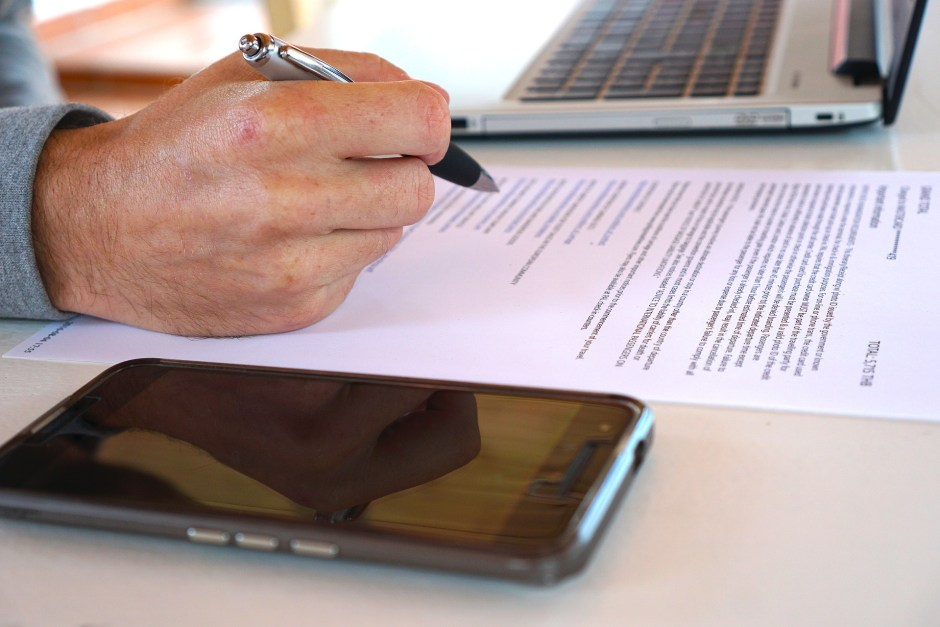 image of a contract being written for blog by Metis HR on can my employees work from home