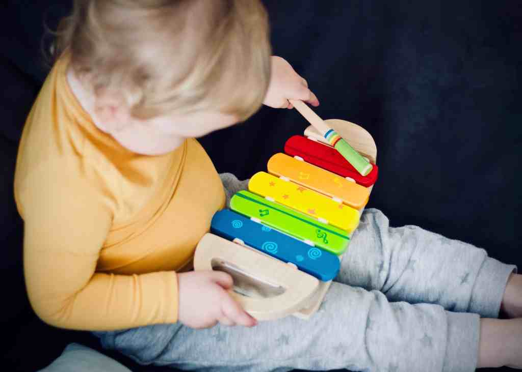 Preschooler with music at home