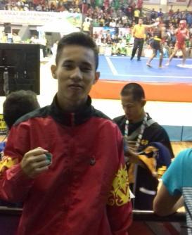 Satria Tri Sakti petarung wushu Provinsi Kaltara berhasil menembus babak semi final di kelas sanshou 48 kilogram putra.