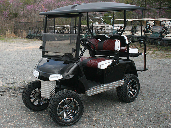 Custom Black with Burgandy Seats E-Z-GO RXV Lifted Golf Cart Diamond Metal Kick Plate side view