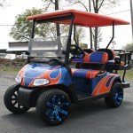 E-Z-GO RXV - blue with orange flame golf cart