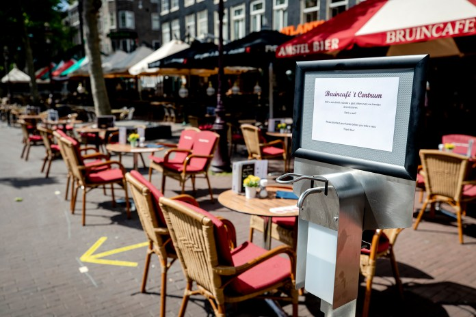 In this photo you can see disinfection gel at a terrace at the Rembrandtplein. Measures to prevent the spread of the coronavirus have been relaxed, including for groups, catering, education and cultural institutions.