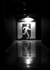 Black And White Hallway Exit Sign
