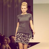 Olivia Simmons, the finalist of Mario, Make Me A Model competition, facing the final challenge of walking the runway during the Fashion Focus Chicago week. Design by C. Dahlstedt.