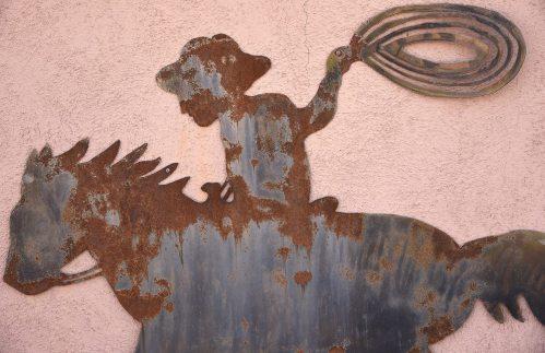 metal art cowboy at a dude ranch