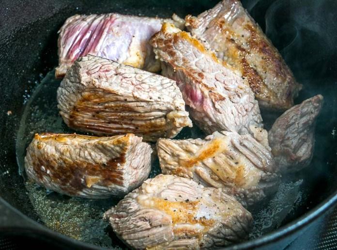 Browning beef brisket in Dutch oven.