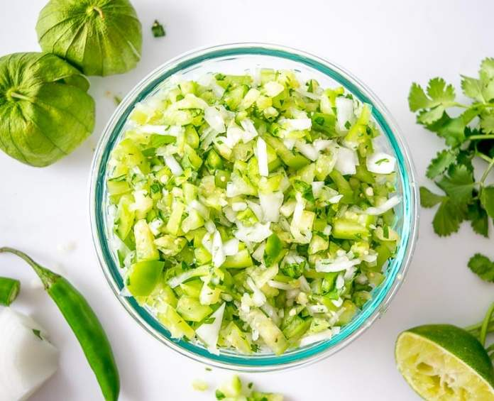 This Tomatillo Pico de Gallo wants to be in your kitchen! Lately I use it for quesadillas and it's always a hit. mexicanplease.com