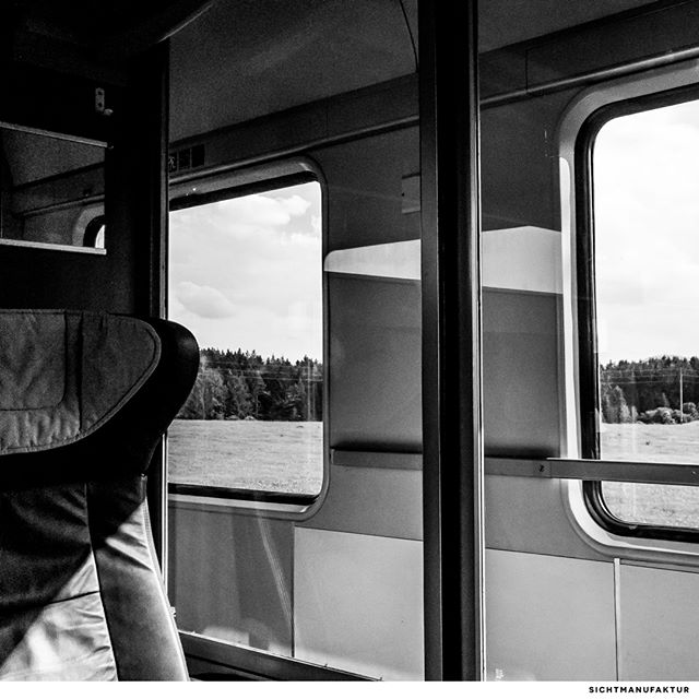 """I really love travelling in the good old IC coaches of @deutschebahn – especially alone in a spacious compartment. Here we are heading to Oberstdorf. Wonderful light and atmosphere of the Allgäu. Moments before being picked up by @mhdistra at Immenstadt to go """"home"""" to Oberstaufen @allgaeu.de @allgaeupictures @oberstaufen_allgaeu @visitallgaeu @samsungmobile_de @blackmoone__37 @blackandwhiteshotz @blackandwhite_photographers @trainspotter_munich"""