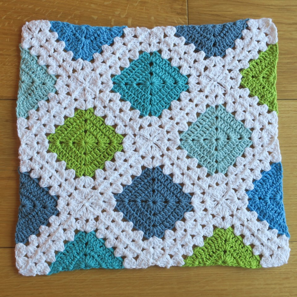 solid squares and triangle crochet motifs joined