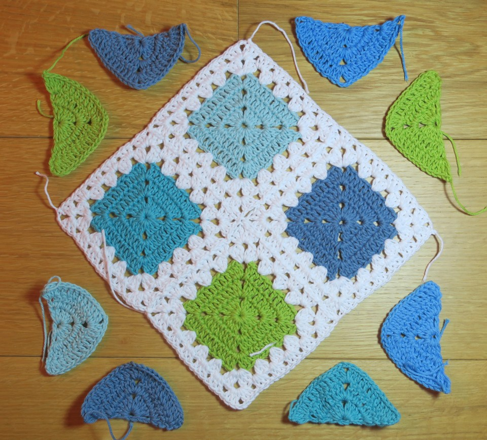 half or triangle crochet motifs in position ready for join