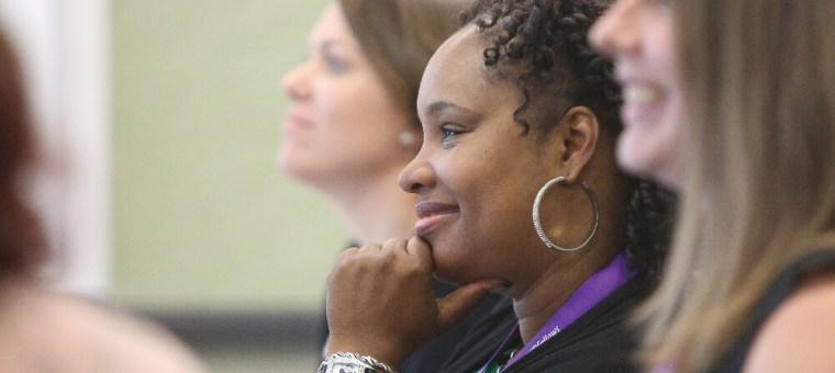 Fellows listen to a presentation