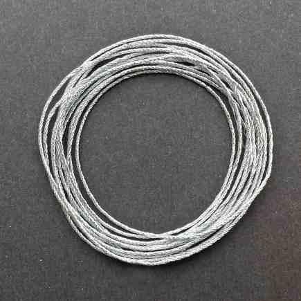 A coil of 4-ply silver metallic lamé.