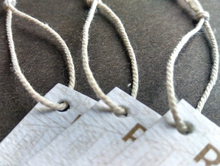 Folded tags strung with Cotton Rope Cord.