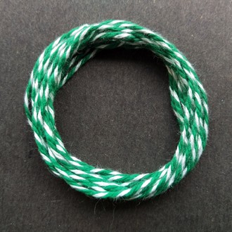 Coil of heavyweight variegated green-white cotton string