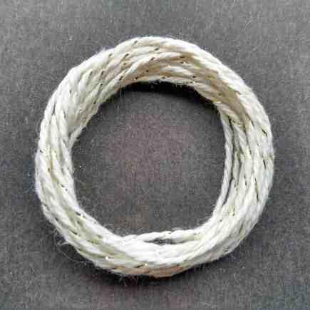 Coil of gold-natural metallic yarn.