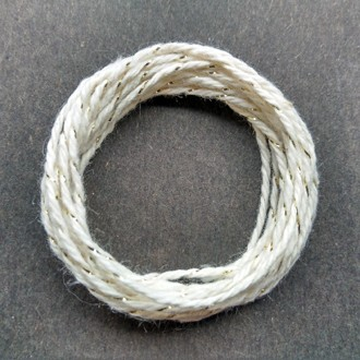 Coil of gold-natural metallic yarn