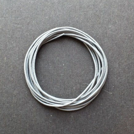 A coil of our gray non-fray elastic.