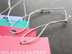 Pastel-colored tags strung with white non-fray elastic.