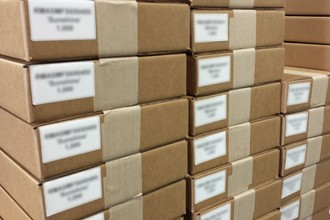Photograph of multiple lots of tags separately packed for a freight shipment.