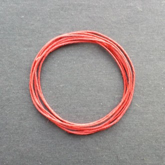 A coil of our red waxed cord.
