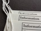 Economically made tags for institutional use strung with standard white rayon string.