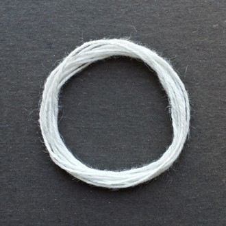 A coil of standard white rayon string.