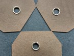 Tags of brown cover stock reinforced with our nickel eyelets.