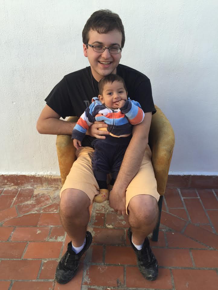 Myself with three month-old Syrian refugee Rambo Hadi, at La Fundación Escuela de Solidaridad, in Granada, Spain. Photo credit to Karen Washington.