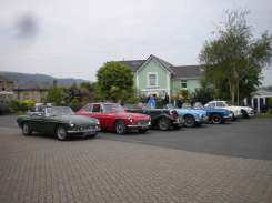 The cars of Hogg, Edwards, Scott, Hubbard, Vickers, Gough and Calvert in the hotel car park; front view