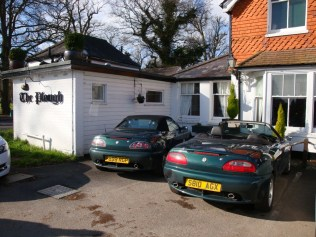 A brace of TFs waiting while their drivers enjoy their lunch at the Plough, Leigh