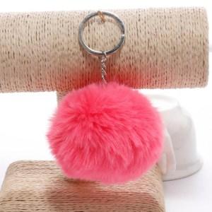 Pörröinen avaimenperä pallo (Tumma Pinkki))
