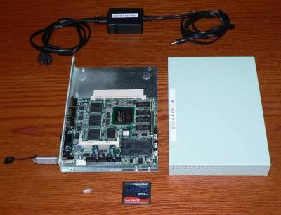 Figure 1: Soekris Net4801, CF card, USB key & power supply
