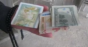 عملات سورية ودولار