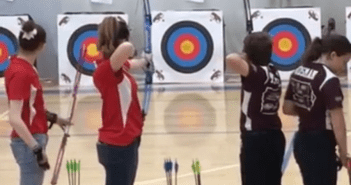 Cappra Svoboda and Madison Berry, both '18, compete in an archery tournament.