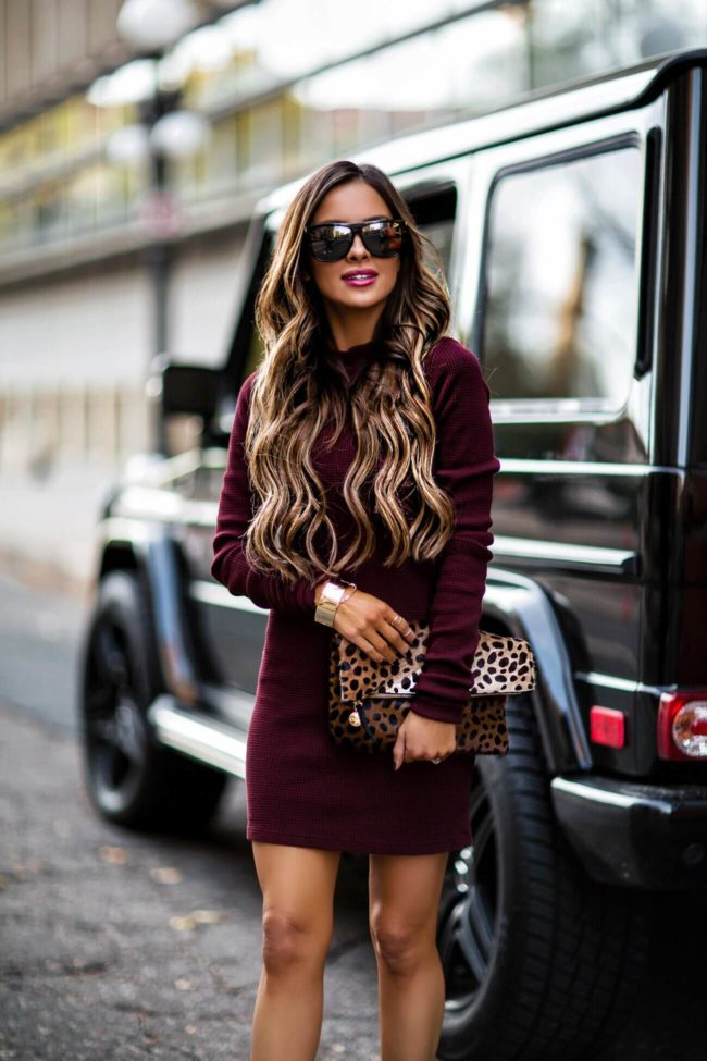 fashion blogger mia mia mine wearing a burgundy dress from intermix and a gold cuff bracelet