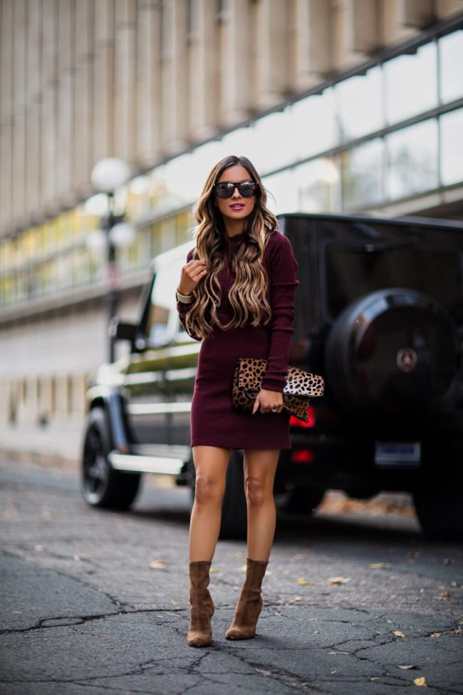 fashion blogger mia mia mine wearing a burgundy dress from intermix