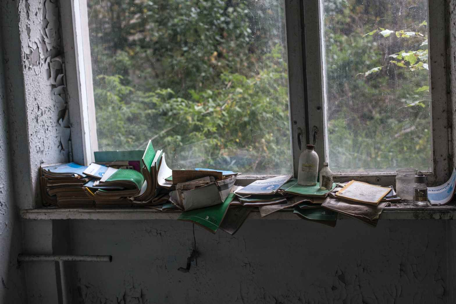 pile of books beside sash window