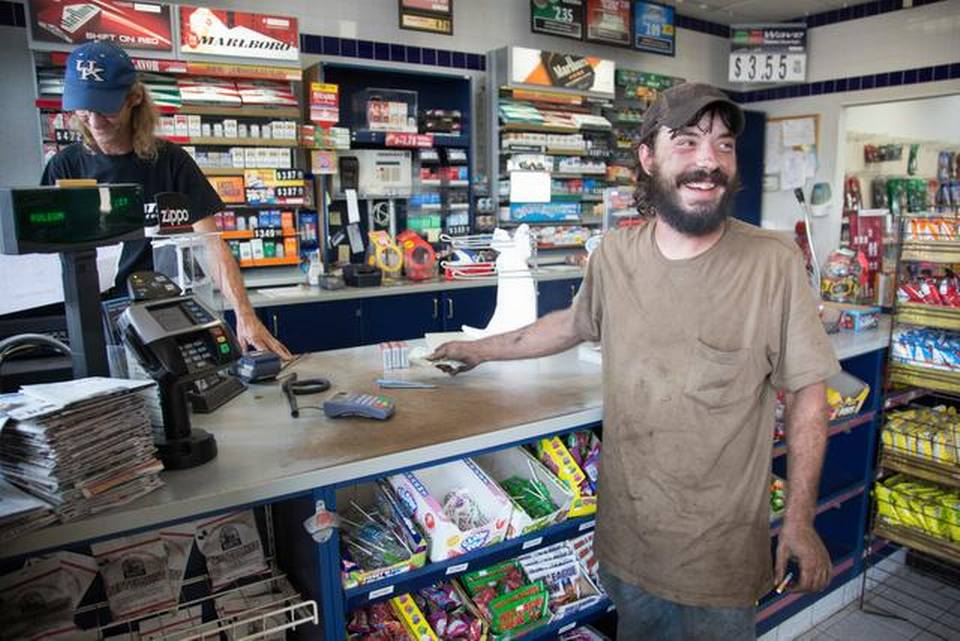 Samuel Riley, right, stops at the Valero gas station after getting off work as a mechanic to buy some cigarettes from Roger Baker in Booneville, Ky. Wednesday August 6, 2014. Booneville and Owsley County are statistically one of the poorest in the country, but many of it's residents find it a good place to live unless you are young and looking for a job.