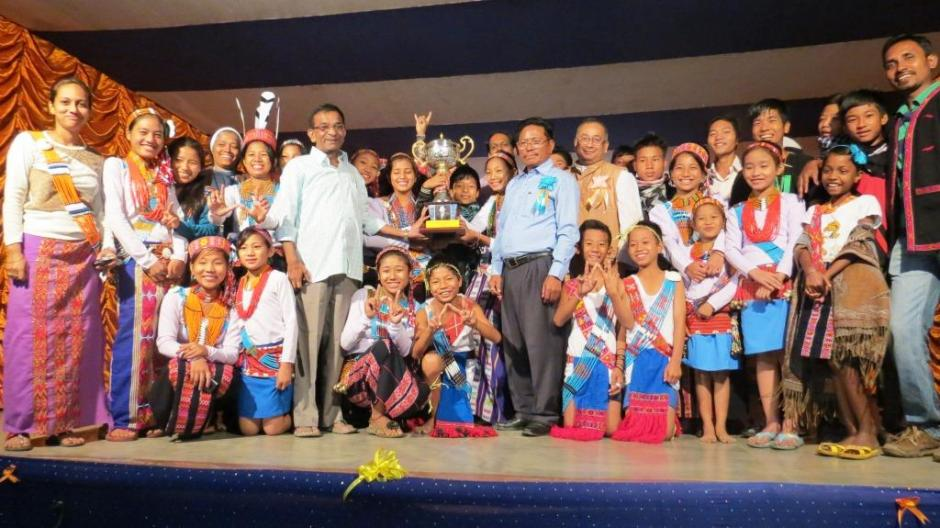 The Students of St. Savio School, Kanubari with thier Overall Champions' Trophy