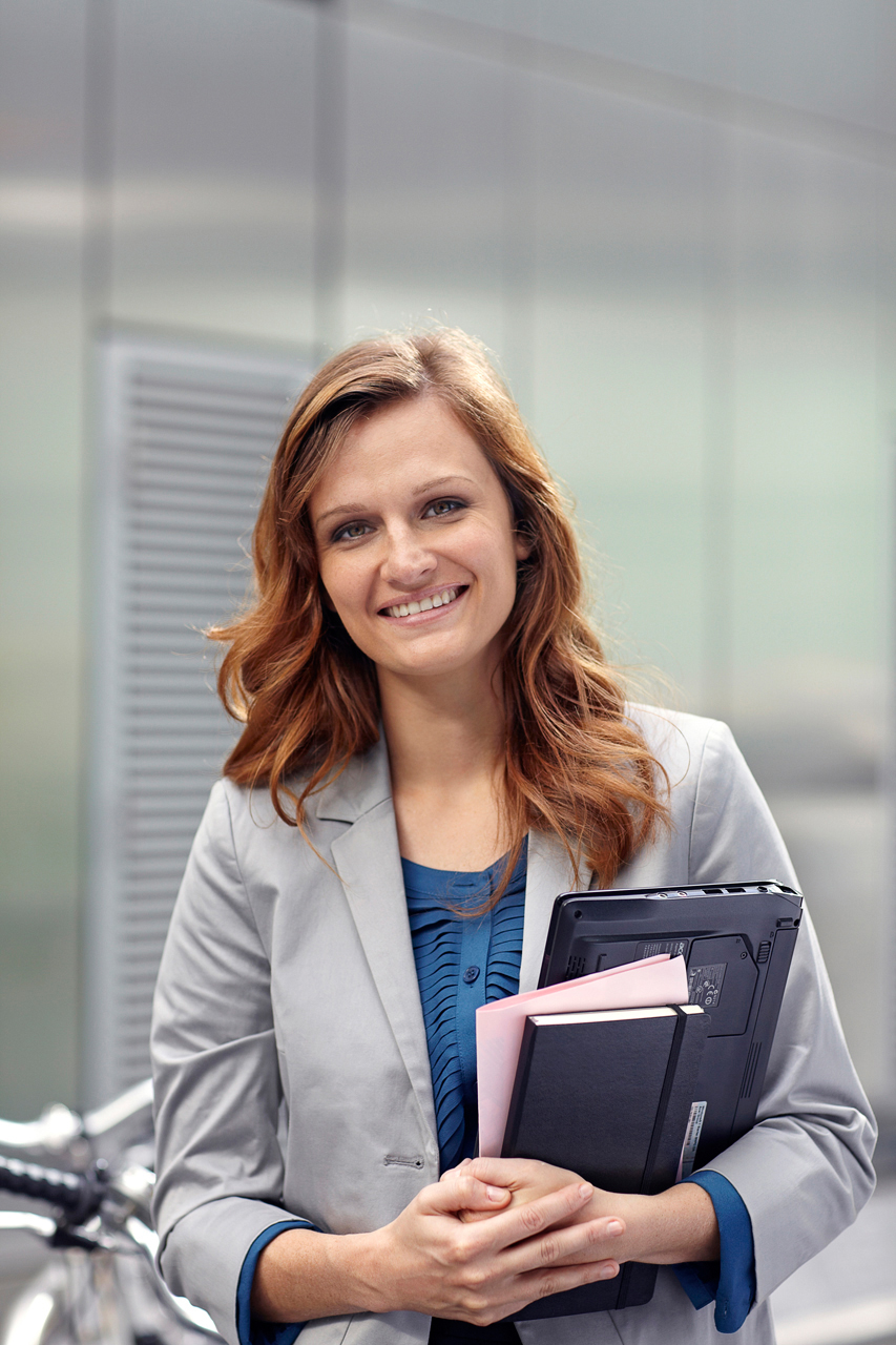 corporate photography portrait of business woman smiling at camera