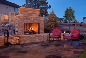 Why You Should Consider an Outdoor Fireplace for Your Winter Landscape this Year
