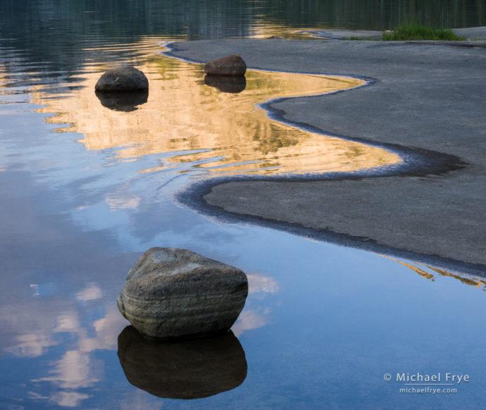 Rocks and reflections along the shore of Tenaya Lake, Yosemite NP, CA, USA
