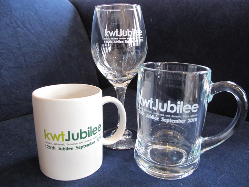 Coffee mugs, wine glasses, beer handles and pens