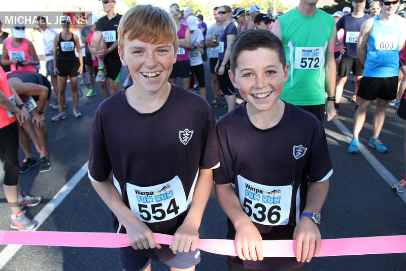 Two lads from St Peters Catholic School Cambridge waiting to compete in the 2014 Waipa Fun Run this morning