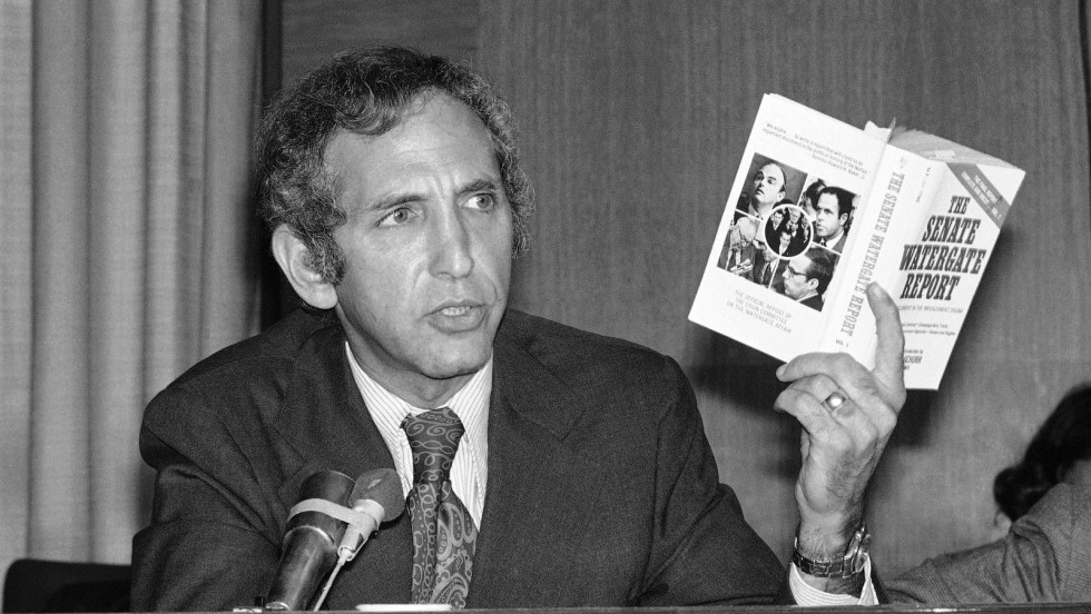 Daniel Ellsberg, the Pentagon Papers figure, holds up a copy of a book entitled ?The Senate Watergate Report? as he appears as a panelist at a conference on the Central Intelligence Agency and covert activities on Friday, Sept. 13, 1974 in Washington. Photo: AP Photo/Henry Griffin