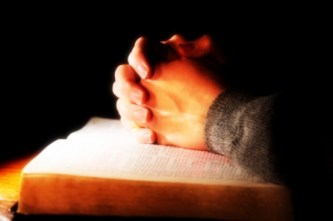 66c5c-praying_hands_bible_070509