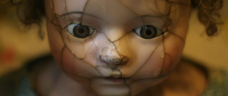 Suffering - doll with a broken face