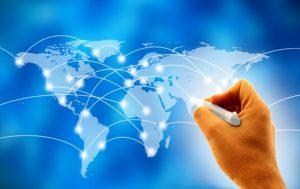 Business man drawing social network or business connections on world map